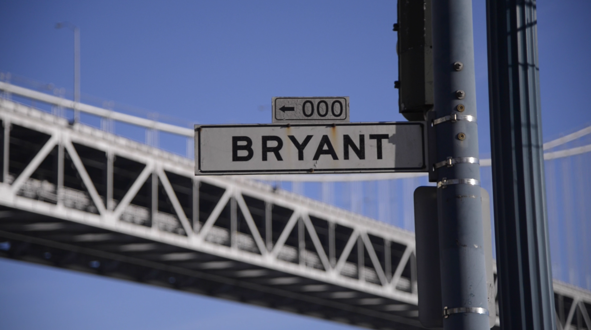 bryant street sign in front of bay bridge